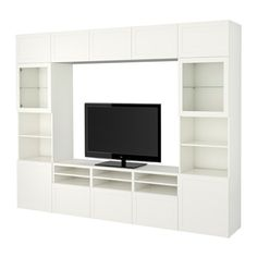 IKEA - BESTÅ, TV storage combination/glass doors, Hanviken/Sindvik white clear glass, drawer runner, push-open, , The drawer and doors have integrated push-openers, so you don't need handles or knobs and can open them with just a light push.This TV storage combination has plenty of extra storage and makes it easy to keep your living room organised.The space-saving wall cabinets make the most of the wall area above your TV.It's easy to keep the cables from your TV and other devices out of…