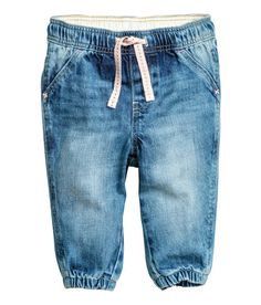 Check this out! Pull-on jeans in soft, washed denim with an elasticized drawstring waistband, mock fly, and mock front pockets. Elasticized hems. - Visit hm.com to see more.