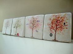 Painted trees on coasters to represent each season