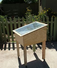 "Solar dehydrator -- ""I based it off a plan in The Solar Food Dryer by Eben Fodor which I borrowed from the library. The materials were nearly all things I already had -- hardware, casters, glass, metal and wood."""