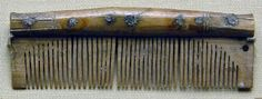 Bone comb; spine of comb with incised cross-hatching and hole which corresponds with another hole in the case.  Graham-Campbell 1980 Composite single-sided comb of antler with convex back which has raised ends and incised ornament. There are two narrow back-plates, three tooth-plates, and seven iron rivets. The ornament, which is the same on both sides, is confined to the ends and consists of two horizontal fields of diagonal cross-hatching, separated by a plain contoured field, defined on…