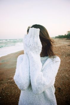 She's beautiful when she hides behind her sweater