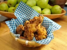 Katie Lee takes us home to West Virginia, making the ultimate comfort food — her Fried Chicken. Learn the dos and don'ts for deep frying and Southern-style tricks to save time and effort in the kitchen. Sunny Anderson makes a comforting side of Easy Baked Sweet Corn and Katie whips up a Sweet Tea Cocktail. Lazarus Lynch from the digital series 'Son of a Southern Chef' stops by to make a crowd-pleasing 'Bama Chocolate Mousse, and the hosts give their verdict on fried, decadent ...