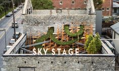 Artist Heather Clark collaborated with Massachusetts Institute of Technology's Digital Structures research group to temporarily transform the burned-and-boarded property into the Sky Stage interactive building-scale public artwork in Frederick, Maryland.