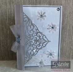 Angela Clerehugh – Create a Card - 5 x 7 Card – Die'sire Create A Card Toulose – Centura Pearl – Die'sire Flowers For All Occasions 3 – Distress ink (Iced Spruce) – Collall Tacky Glue – Red Tape – Acetate – Silver Card – Paper from own stash – Ribbon – Gems - #crafterscompanion