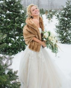 A fur coat is such a great idea for a wedding cover up.