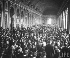 The signing of the Treaty of Versailles in France, 1919.