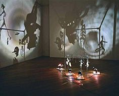 Christian Boltanski (born 1944) is a French sculptor, photographer, painter and film maker.  In 1986, Boltanski began creating mixed media/materials installations with light as essential concept. Tin boxes, altar-like construction of framed and manipulated[1] photographs (e.g. Chases School, 1986–1987), photographs...  all those elements and materials used in his work are used in order to represent deep contemplation regarding reconstruction of past.