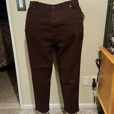 Denim and Company chocolate brown jeans Cotton spandex blend chocolate brown 5 pocket jeans. Front pockets are embellished with copper rivets matching the button on the zipper fly. Medium weight. Inseam 29 inches. Brand new with tags and never worn. Denim and Company Pants Straight Leg