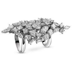 La bague Fantasy Cut de Damiani en or blanc et diamants de différentes tailles et caratages (baguette, brillant, émeraude, marquise) http://www.vogue.fr/joaillerie/le-bijou-du-jour/diaporama/la-bague-fantasy-cut-haute-joaillerie-de-damiani/18887/carrousel#la-bague-fantasy-cut-de-damiani-en-or-blanc-et-diamants-de-diffrentes-tailles-et-caratages-baguette-brillant-meraude-marquise