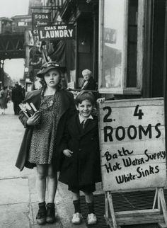 Bath, hot water supply, white sinks.. New York, 1930's