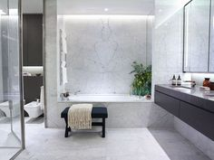Use The Same Tiles Throughout To Create A Stylish Family Bathroom
