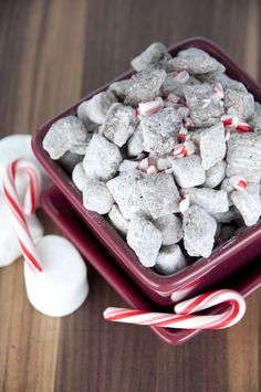 Muddy buddies made with Rice Chex, hot chocolate mix, and melted chocolate for an easy holiday or winter snack! This will be your new favorite puppy chow.