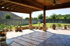 pergola with travertine stone posts