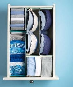 Cut shoe boxes in half, along the length or width, and fill the resulting compartments with folded briefs, socks, or stacked bras.