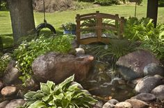 Beautiful natural styled pond for the backyard. I want!!