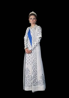 Empress Farah of Iran in a white evening ensemble with typically PERSIAN embroidered motifs.