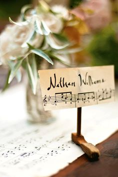 Handmade place cards inspired by vintage sheet music and attached to antique piano keys! (photo by Barrett Doran)