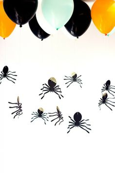 .Attach Spider cut outs to balloons for Halloween party