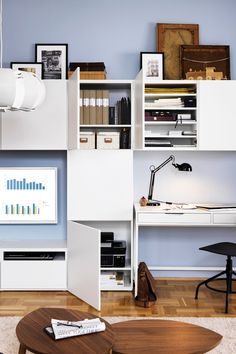A home office for the organization lover in all of us! The IKEA ALEX desk has built-in cable management for collecting cables and cords out of sight but close at hand. And because the back of the desk is finished, it can be placed anywhere in the room!