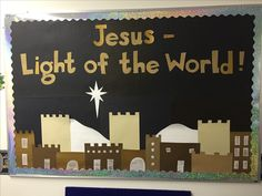 """Christmas bulletin board for 2016! """"Jesus - Light of the World!"""" Used the town idea from another bulletin board I found on Pinterest, and changed the wording to fit our theme."""