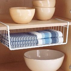 ooh, i should attach some undershelf baskets to the shelf in my bedroom closet. that's a bunch of empty space that could hold some small things.