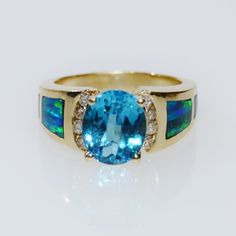 Blue Topaz, Australian Fire Opal and Diamond 14k Yellow Gold Ring https://www.etsy.com/listing/466128978/december-and-october-birthstones-blue?ref=shop_home_active_18