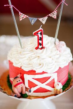Check out the cute barn inspired birthday cake at this Farm 1st birthday party. Stunning!! See more party ideas and share yours at CatchMyParty.com #catchmyparty #farmbirthdaycake #farmbirthdayparty