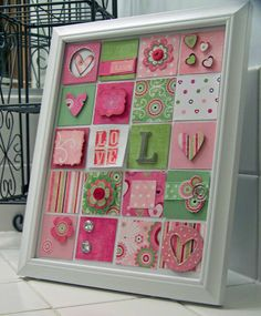 Framed Art - Scrapbook.com  Like a little framed quilt.  Personalize with colors, patterned scrapbook papers and doo-dads.