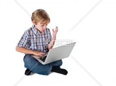 boy surfing on laptop. - Boy surfing on laptop against white background.