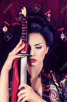 Beautiful Geisha In Kimono With Samurai Sword Stock Photo, Picture And Royalty Free Image. Image 22612903.