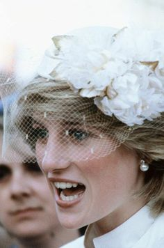 Diana in white floral hat with birdcage netting