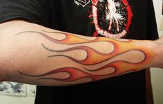 Travis always wears shorts (even in the dead of winter) because he likes to show off a flame tattoo that encircles his right calf.