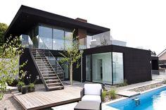 Nilsson Villa-Modern Beach House With Black and White Interior Design in Sweden