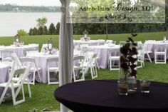 purple wedding flowers as reception centerpieces for an outdoor wedding by AntebellumDesign.com