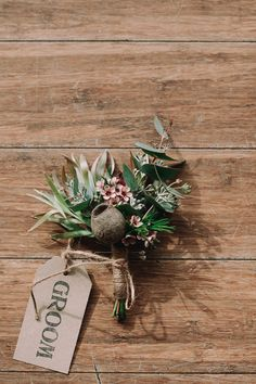 Native boutonniere with gum nut, eucalyptus, wax flower and leucadendrons.  Swallows Nest Farm