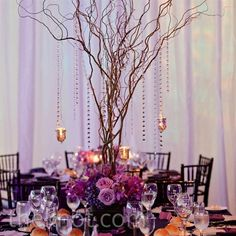 love the branches and the height. would love to see with strings of emeralds and white flowers at the base.