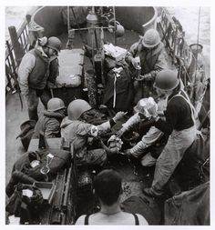 Medical transport craft for men wounded in the first wave of American troops landing on D-Day off Omaha Beach Normandy 1944 [651 x 700]