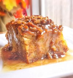This amazing holiday dessert consists of a bread pudding with a pumpkin custard filling and topped with a pecan praline sauce.
