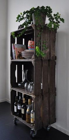 Outdoor parties – Love the use of these old crates stacked and mounted with caster wheels-stack dishes and glasses ETC. or even different heights next to each other with plants.