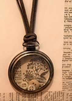 Sweet. You could do this using tiny frames or old pocket watch cases, which is what this appears to be made from. (Didn't click through. Photo's pretty self-explanatory.) 52 FLEA