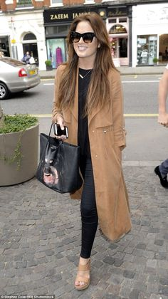 Going wild: Binky was carrying a funky leather bag by Givenchy for the occasion which had ...