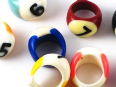 Used pool (billiard) balls upcycled into unisex rings, made by Eleanor Salazar.