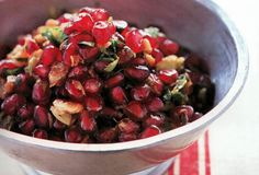 Tyler Florence's Pomegranate Walnut Relish from Leite's Culinaria - uses 1/2 cup pomegranate seeds, 1/4 cup celery leave, 1 tbls. parsley, zest of 1 small organic orange, 1 tbls. lemon or pomegranate juice, 1/4 cup walnut pieces, and 3 tbls. extra-virgin olive oil. Serve with seared sea scallops or chicken thighs.