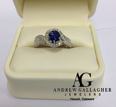 (11/25/15) 50% OFF! 14K White Gold Blue Sapphire and Diamond Ring. | The Diamond weight is 0.3 carats total weight and the round blue sapphire is 1.32 carats. The sapphire is set in a six (6) prong 14K white gold box. Original Retail Price: $2700.00 SALE PRICE: $1350.00. | I Call Andrew Gallagher Jewelers at 302-368-3380 for more information. We SHIP!! | #50OffJewelryCase