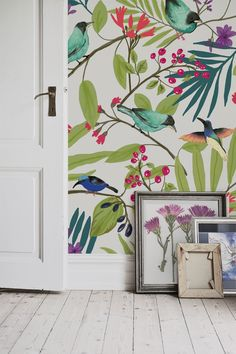 Love this illustrated wallpaper design. Beautiful and exotic birds showcase their colourful feathers while trying to nip at the shiny red berries. It's perfect for hallway spaces and would look delightful in the kitchen.