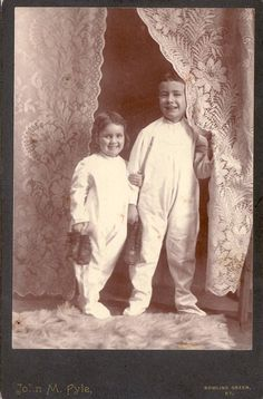 Vintage Cabinet Card Sister and Brother in Denton Sleepers Holding Shoes