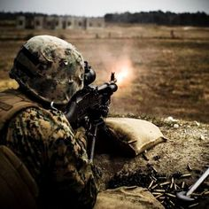 US Marine fires an machine gun during a combined arms exercise at Camp Lejeune Marsoc Marines, Camp Lejeune, Special Operations Command, Ear Protection, Navy Sailor, Army Soldier, American Soldiers, Military Life, Coast Guard