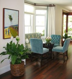 Kitchen nook seating includes cozy bench seating and bright colored tufted chairs