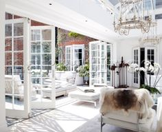 Air circulation from courtyard garden to conservatory extension in London home  UK